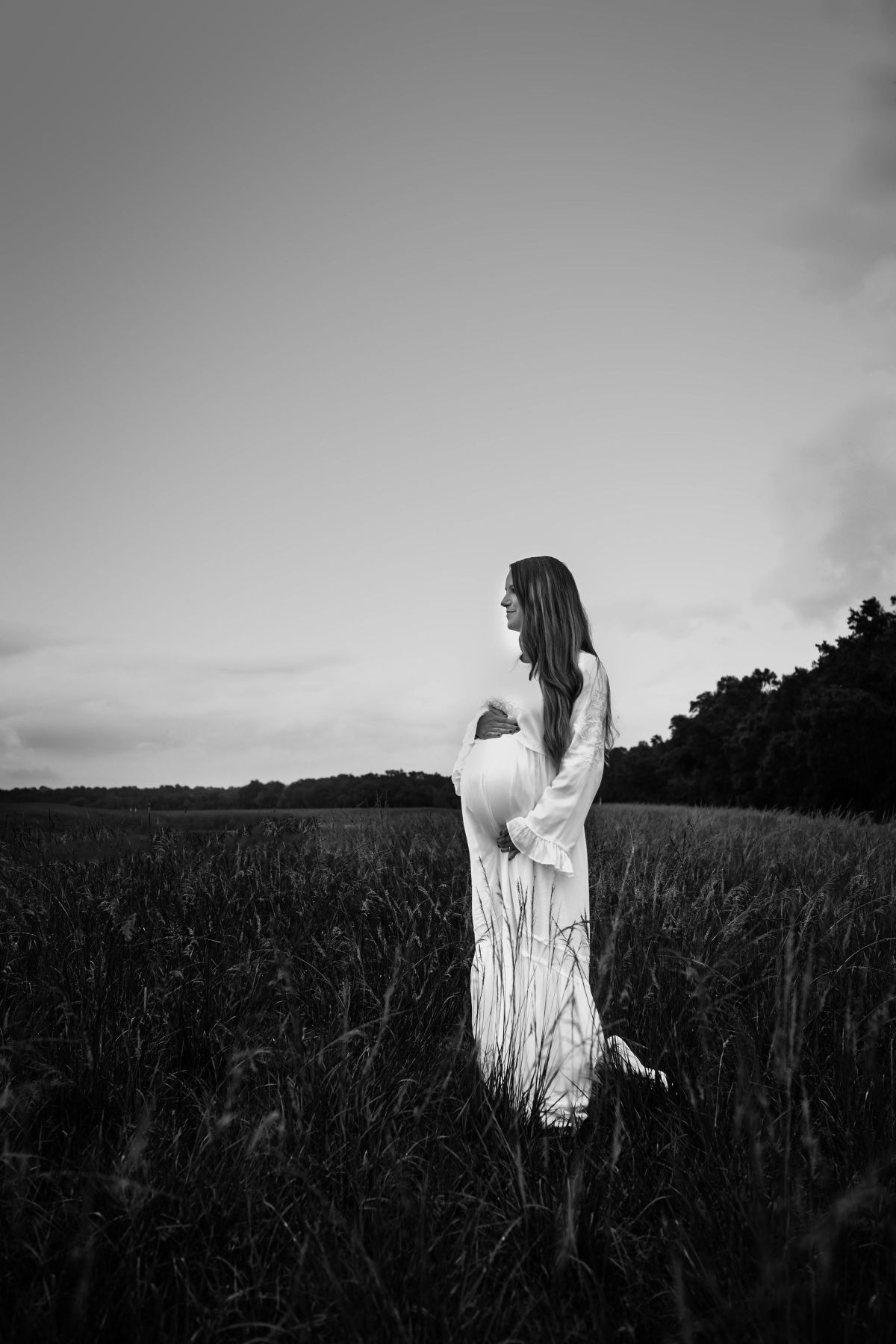 pregnant mother standing in a tampa fl maternity session