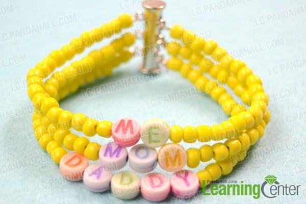 Finish making personalized family bracelet