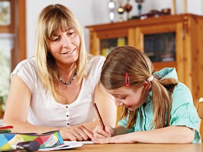teenage girl and mother doing homework