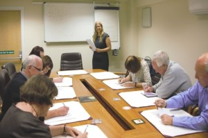 Image showing managing director training a group of adults in a boardroom