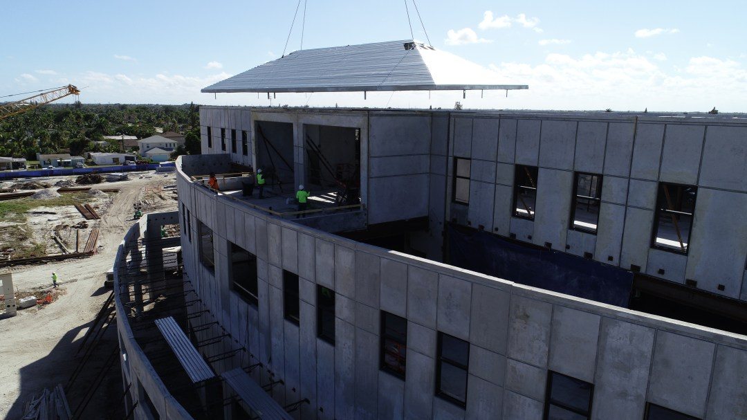 Roof being lowered onto the top of Boynton City Hall & Library