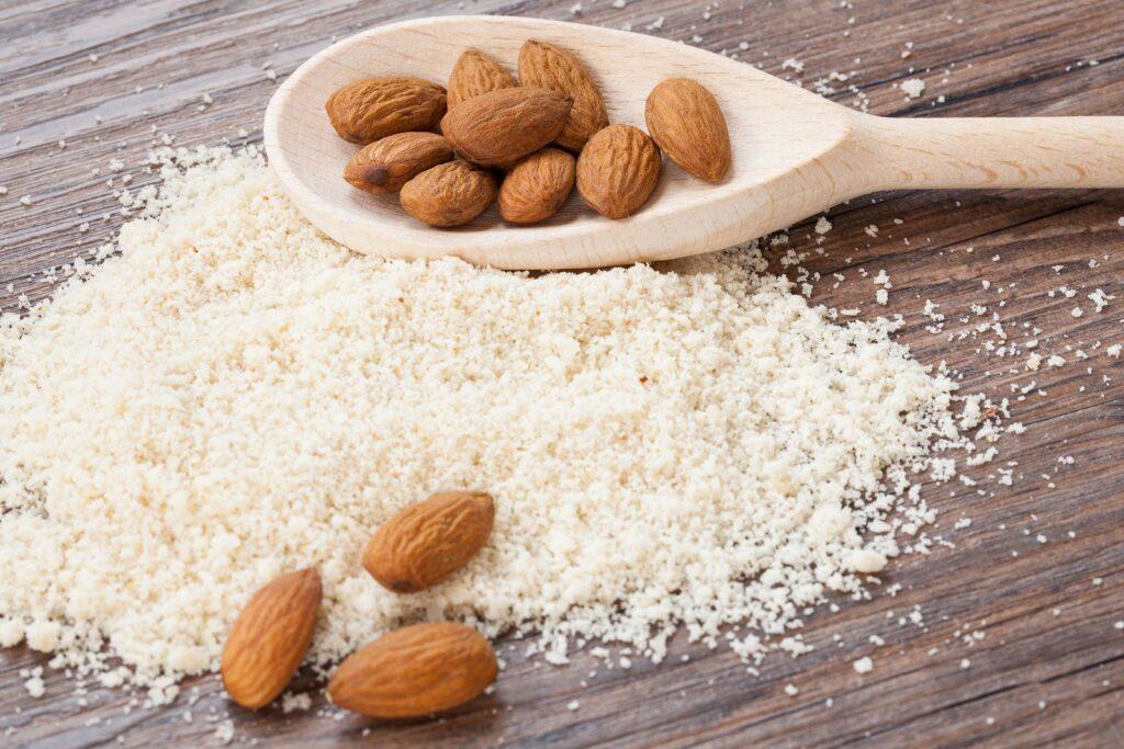 almond flour almonds in a dark wood background