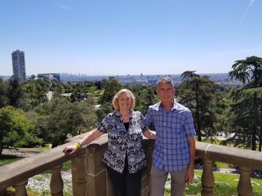 Elayne Bendel and Jim Ayres with city views.