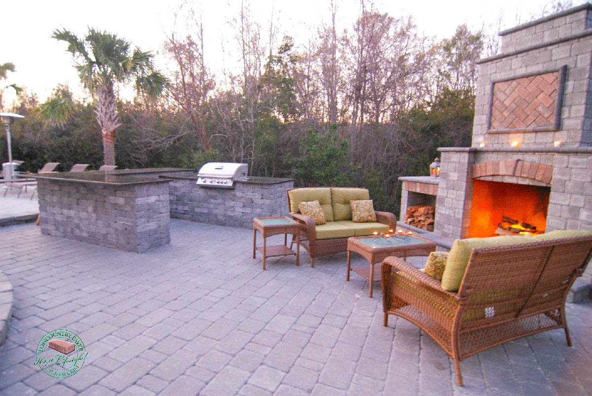 outdoor kitchen with fireplace ikea sink cabinet and lowcountry paver