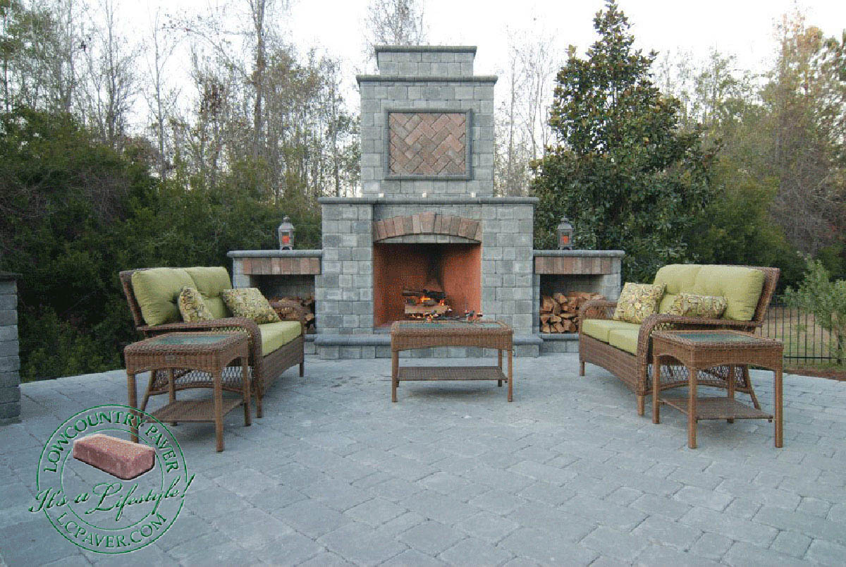 outdoor kitchen with fireplace glass tiles and lowcountry paver