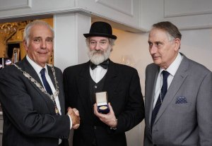 Mike Lawrence (centre) being presented with the Roll of Honour medal by L&CPU President, Garth Tighe with Gordon Jenkins, PAGB President (right).