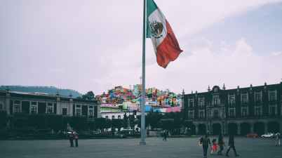 people near mexican flag