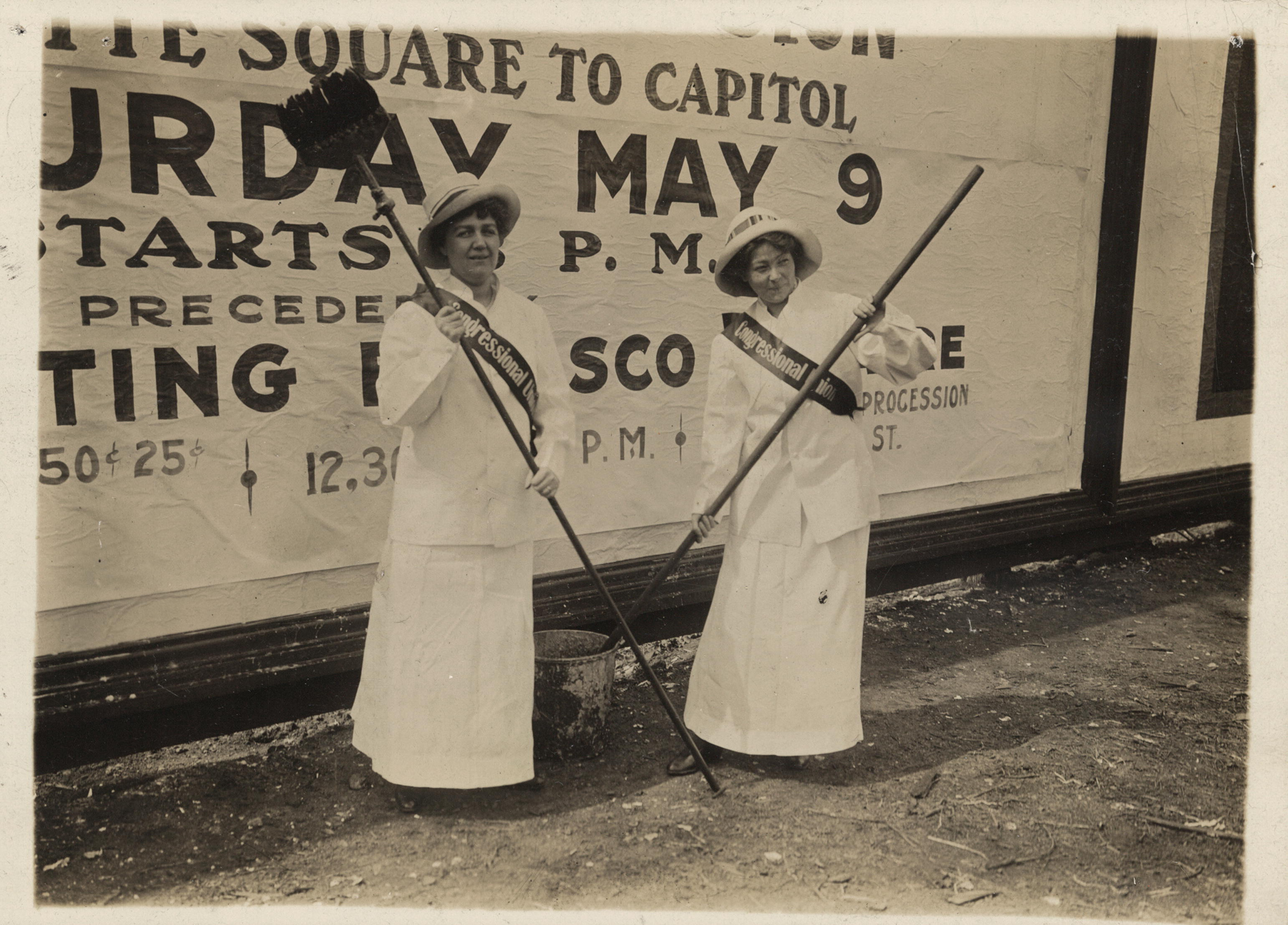 Members of the Congressional Union pasting advertisements