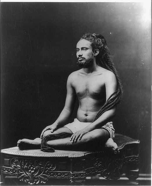 [Priest sitting. India. 189-?]