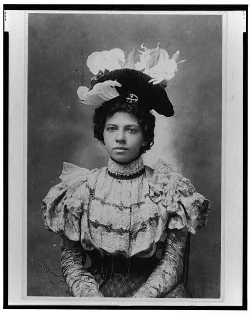 [African American woman, half-length portrait, wearing hat, facing front]