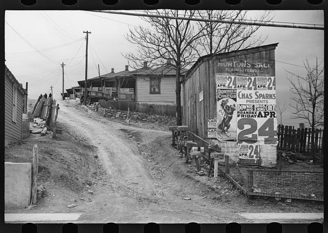 [Untitled photo, possibly related to: [Posters covering a building near Lynchburg to advertise a Downie Bros. circus]]