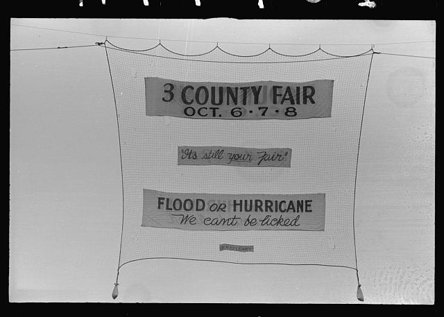 A sign advertising a country fair