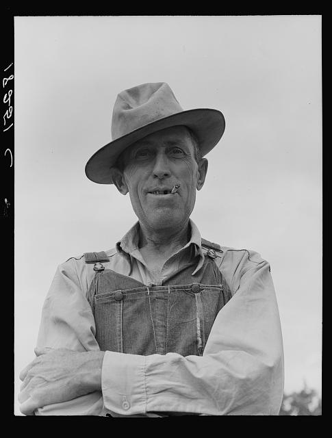 "Man living on ""Scratch Hill"" outside Atoka, Oklahoma. Atoka County, Oklahoma. ""I'm going west because this country's through, there isn't anything here for anyone. I'm going west to Lubbock and Arizona. Last year I worked in the cotton"""