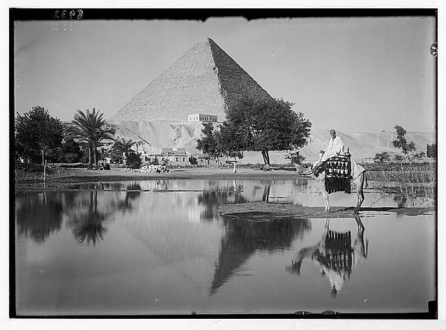 Egypt. Pyramids of Gizeh. The Great Pyramid. Reflecting pyramid & mounted camelman