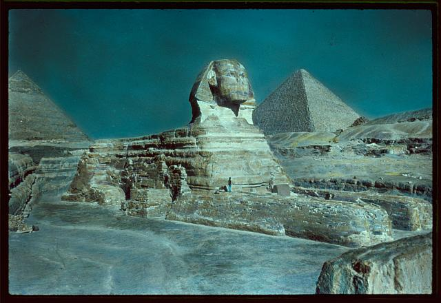 Egypt. Pyramids. The Sphinx and pyramid, from low viewpoint looking up