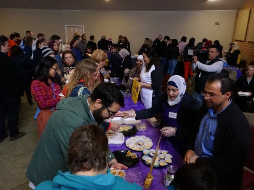 Syrians are serving the crowd of people who turned out to support refugee families.