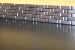 Stainless steel tile backsplash with salvaged slate countertop.