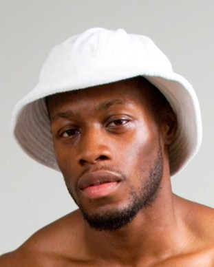 model with beard and white terry cloth hat