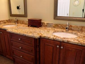 Granite bathroom top following cabinets shape