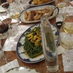 Potato millefeuille and fine beans with yellow courgettes