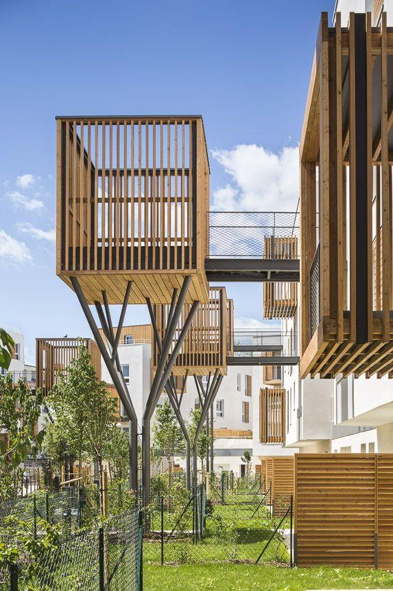 # 以社區交流為概念的陽台公寓:位於法國巴黎羅曼維爾郊區 11