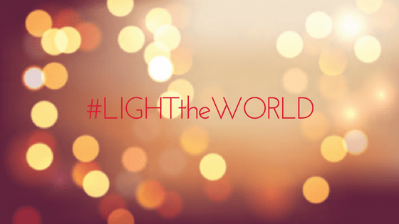 "Light the World: soft gold and red lights with the text ""#LIGHTtheWORLD"""