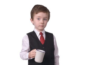 Young Boy Dressed In Suit With Coffee