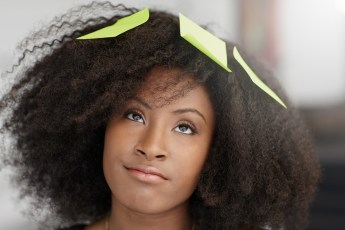Portrait of a smiling business woman with an afro in bright glas