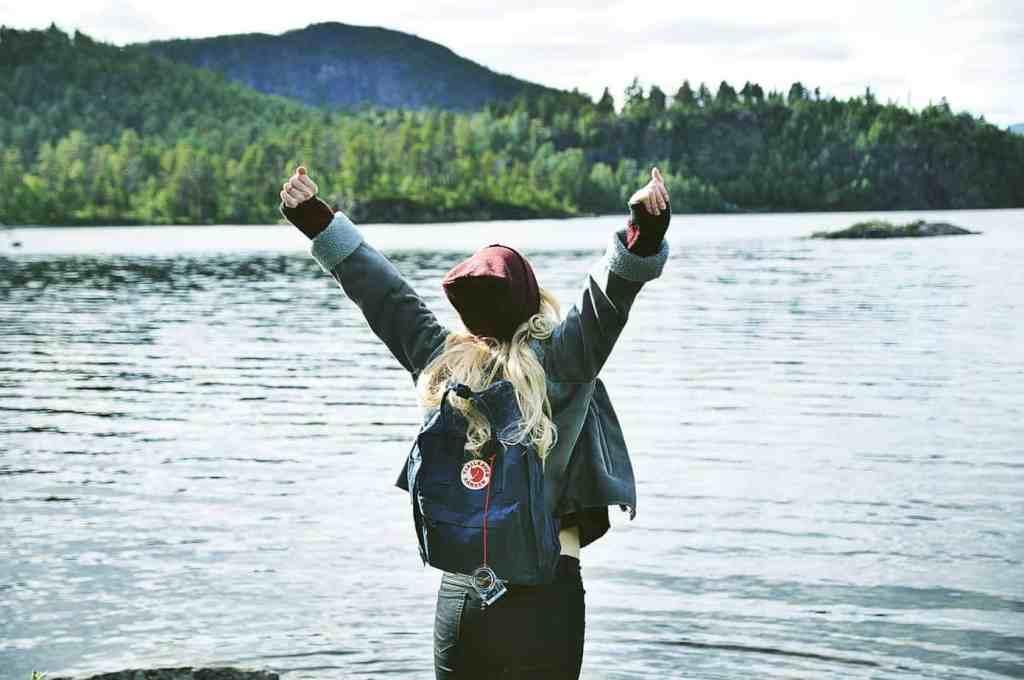 Woman raising her hands