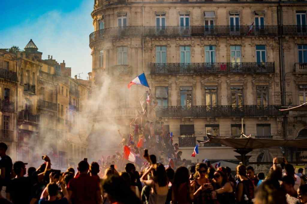 Group gathering with French flags