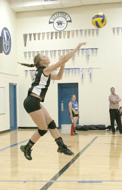 Madelyn Vollmer (6) of the Davidson/Loreburn RaiTec delivers a jump serve during the team's home tournament, held Sept. 11 and 12 in Davidson.