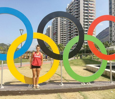 Canadian shot putter Taryn Suttie poses with the rings at the Olympic Village.