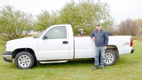 Bill Hannah stands beside the trusty pickup truck that's taken him to many meetings on behalf of the R.M. of Rosedale. He's been the councillor for Division 1 since January 1982.