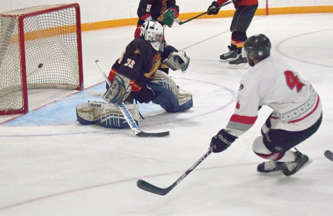 The Davidson Cyclones' Brett Ward shoots the puck past Drake Canucks goalie Calvin Bartel during Wednesday's game, thus reclaiming the lead in the third period.