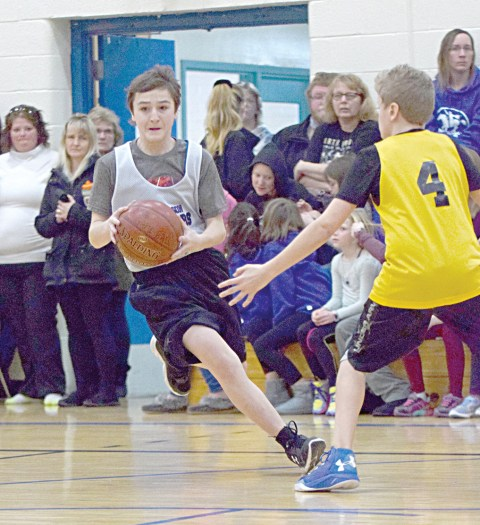 Davidson's Deiondre Boychuk is seen in action during Wednesday's junior boys basketball game against Kyle.