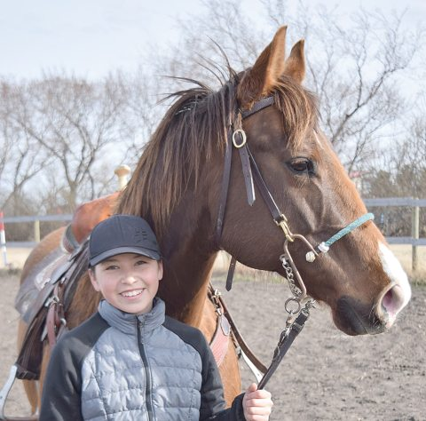 Kiana Ehmann poses with her American quarter horse mare Ginger.