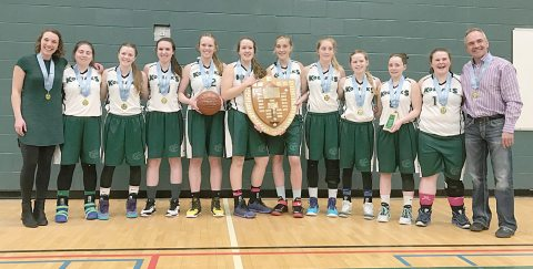 The Kenaston Kodiaks pose with the championship plaque after winning gold at 1A senior girls basketball provincials in Regina on March 25. Pictured are (from left) coach Jenna Zdunich Fisher, Jessica Zdunich, Calina Evans, Leah Libke, Alyssa Evashenko, Ann Ulmer, Eve Matovich, Rachael Matovich, Morgan Taylor, Kylee Evans, Anne-Marie Collins and coach Gene Zdunich.
