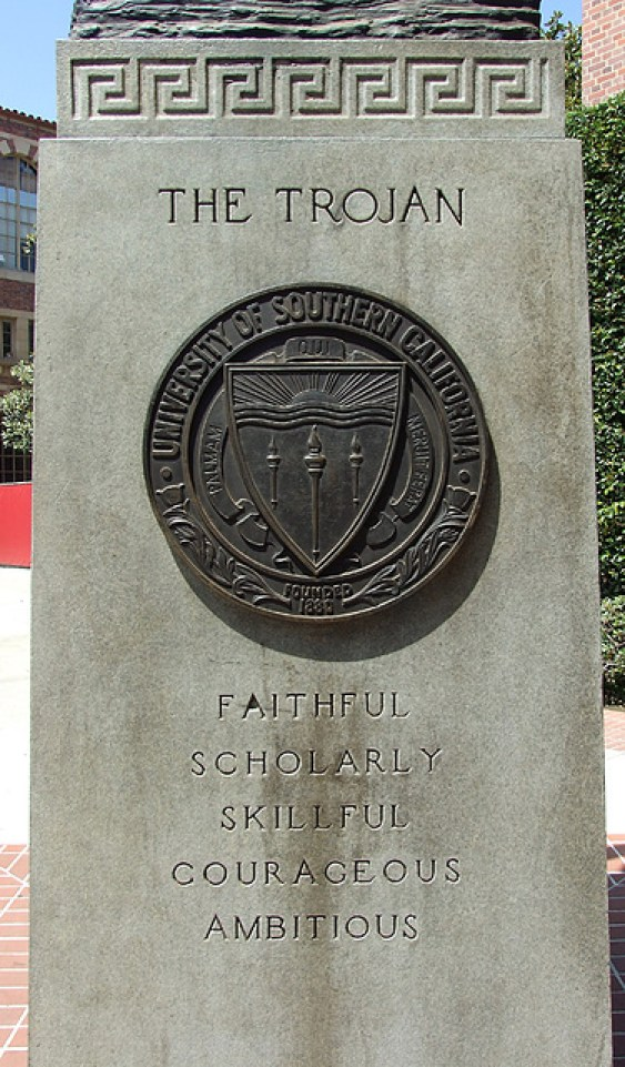 USC Tommy Trojan at the University of Southern California. The USC Seal is in the center with the five traits of the Trojan listed below: Faithful, Scholarly, Skill, Courageous, Ambitious