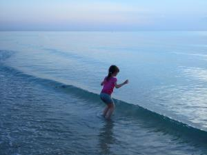 girl-is-jumping-in-a-cold-water