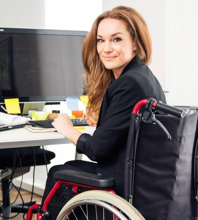woman in wheelchair at work station
