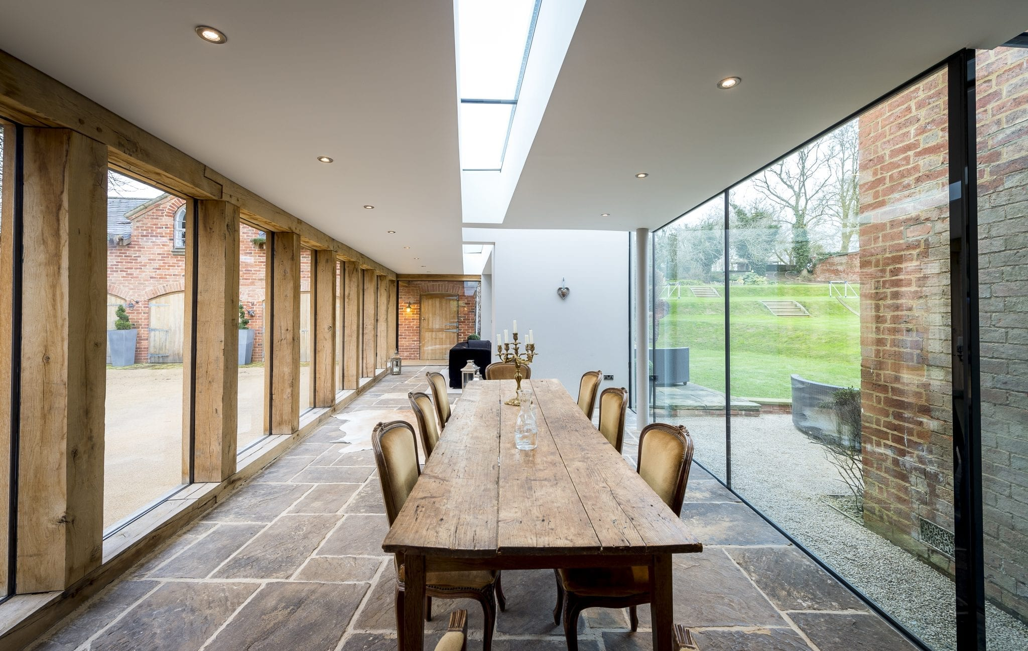 Contemporary Oak  Glass Extension to Listed House  Leaf