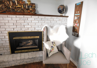 chair after fireplace whitewash brick DIY