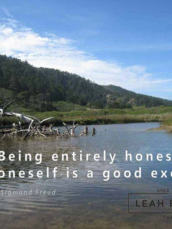 "A color photo of mountains and a river with a quote from Freud, ""Being Entirely Honest with Oneself is a Good Exercise"""