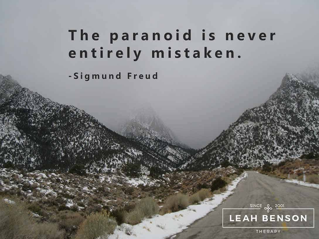 """Photos of snow covered mountains with the quote, """"The Paranoid Is Never Entirely Mistaken"""""""