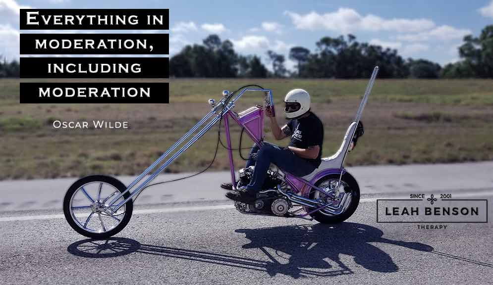 """Photo of a guy riding a chopper with text, """"Everything in Moderation, Including Moderation """""""