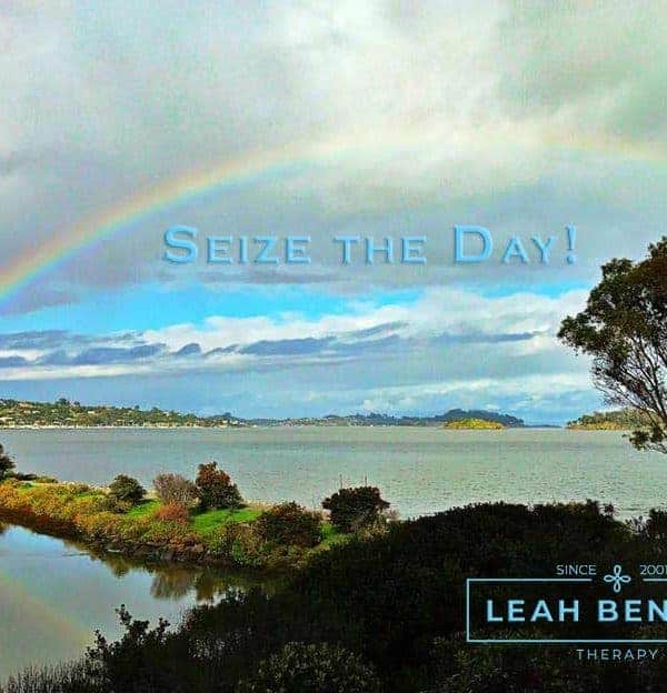 "Color photo of rainbow over San Francisco bay with the words, ""Seize the Day"""