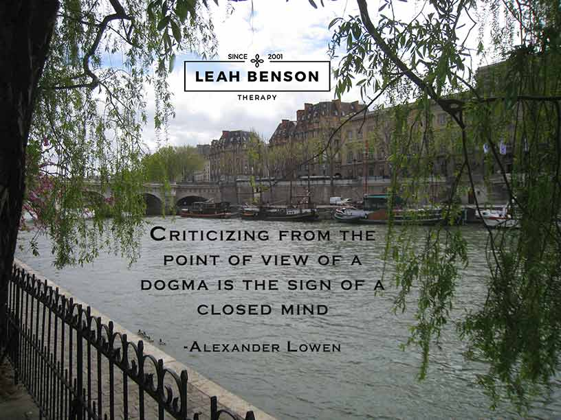 """Photo of Seine River in Paris with boats and a bridge. Quote by Alexander Lowen, """"Criticizing from the point of view of a dogma is the sign of a closed mind"""""""