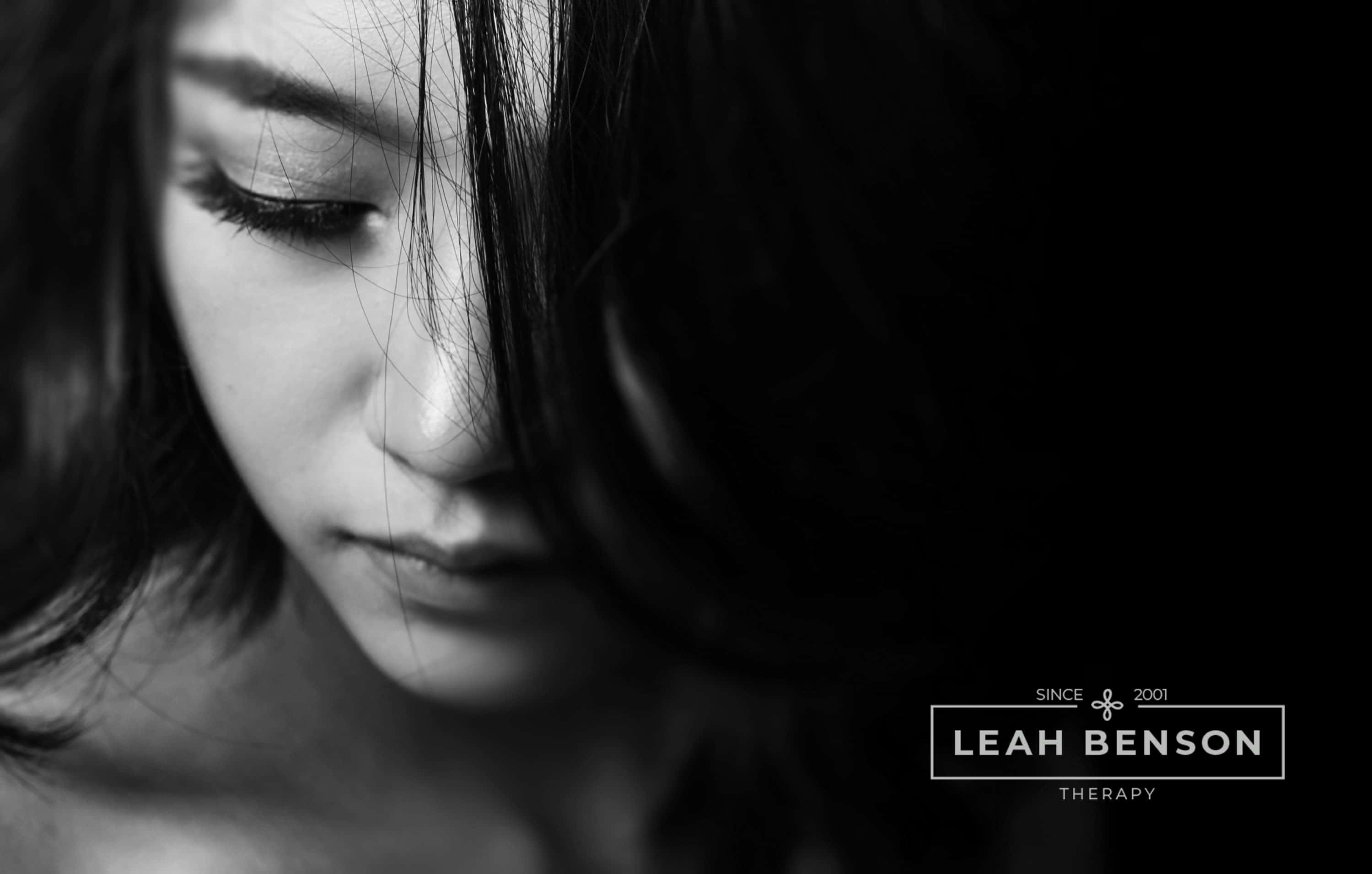 pensive attractive young women dealing with a breakup. LEAH BENSON THERAPY logo shown