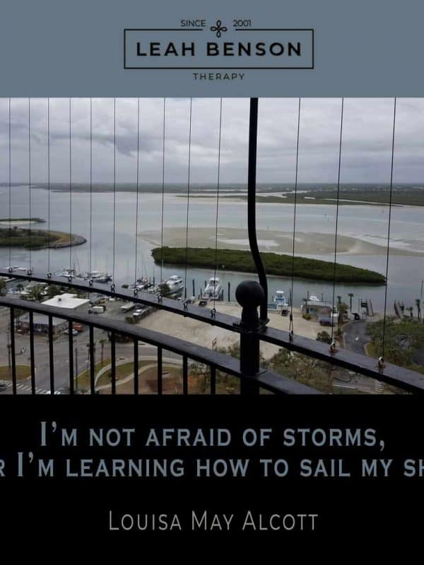 I'm not afraid of storms, for I'm learning how to sail my ship. Quote by Louisa May Alcott. Photo of boats and the sea.