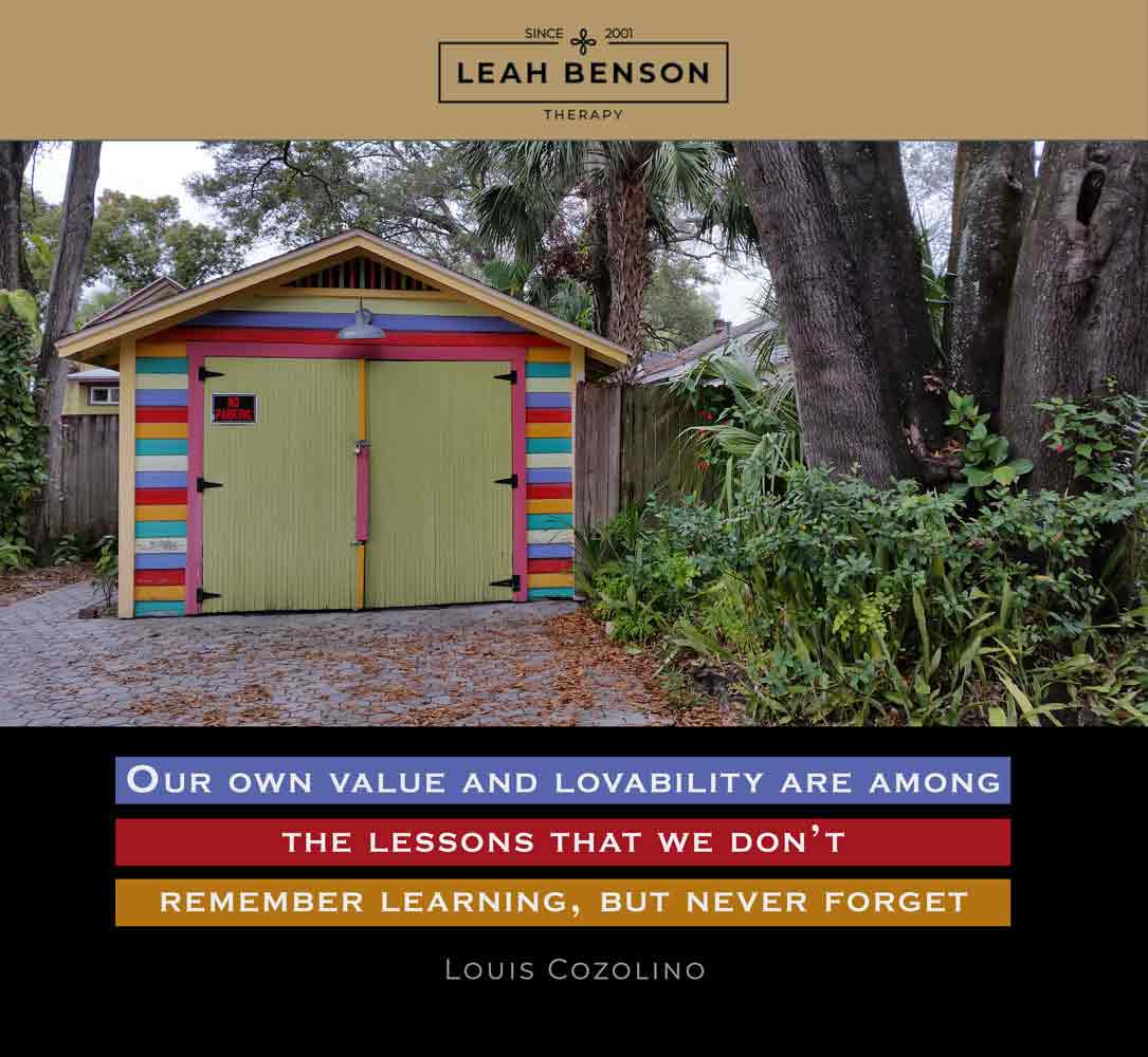 """""""Our own value and lovability are among the lessons that we don't remember learning, but never forget"""" quote by Louis Cozolino - photo of a colorful garage and palm trees."""